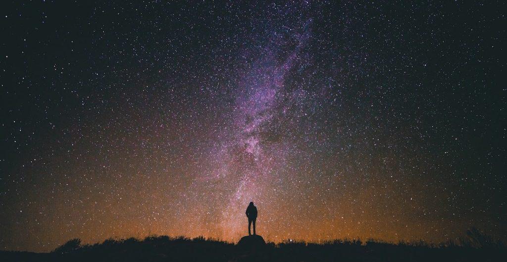 Man looking at universe